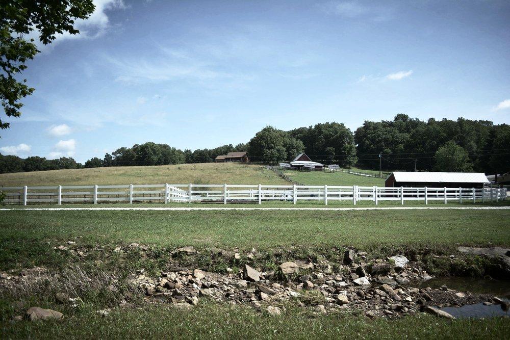 white fence cabin.JPG