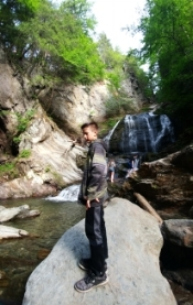 Hiking with grandson Kai. Stopped to see the waterfall in Stowe, VT..