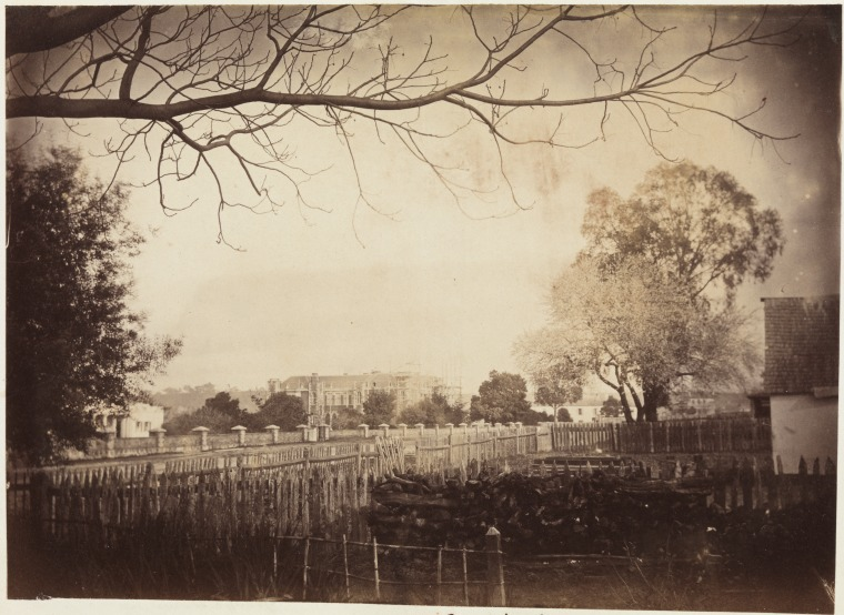 Old Government House at left, New government House under construction at centre, ca 1862