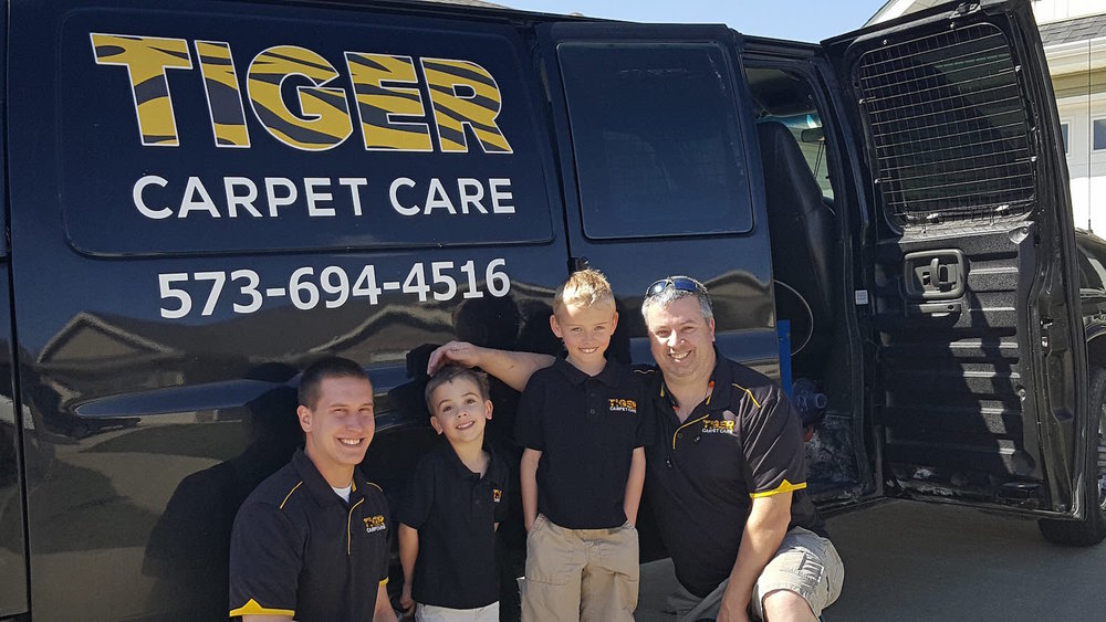 Tiger Carpet Care Team in front of their van