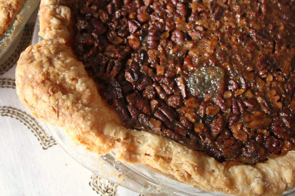 a beautiful shot of the pioneer woman's pecan pie before slicing