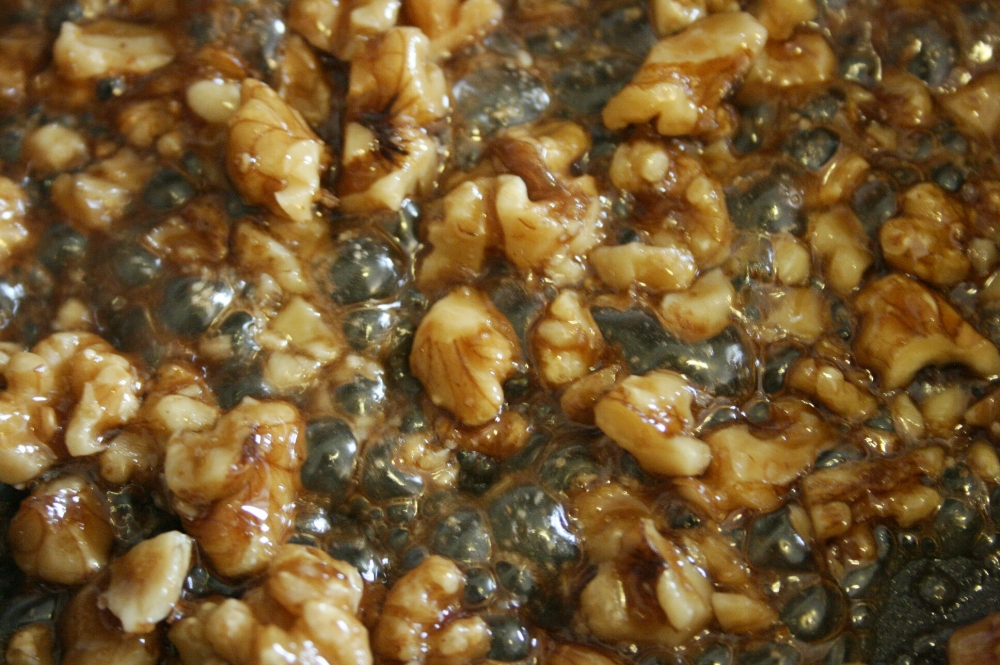 candied walnuts simmering in brown sugar and butter