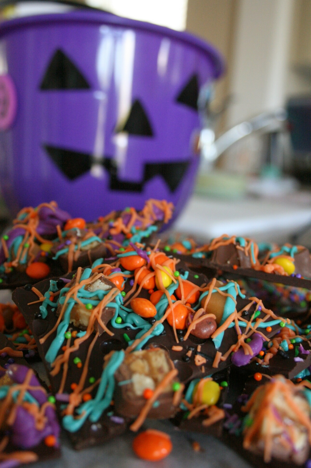 Recipe for a fun and festive Halloween treat! This chocolatey bark is simple to make and great to create with the kids. From TheBakeSite.com