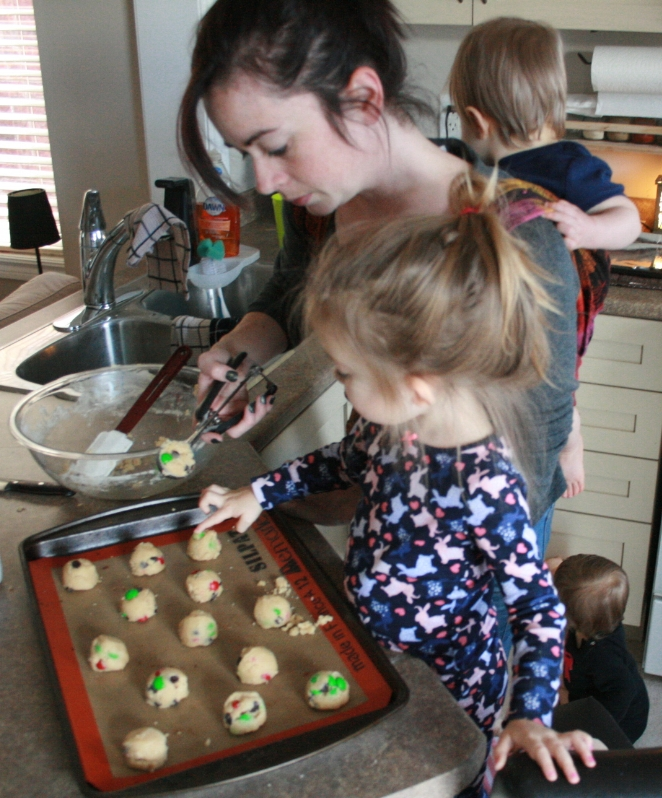 Family baking Christmas cookies together in the kitchen with Bake's gourmet baking mixes