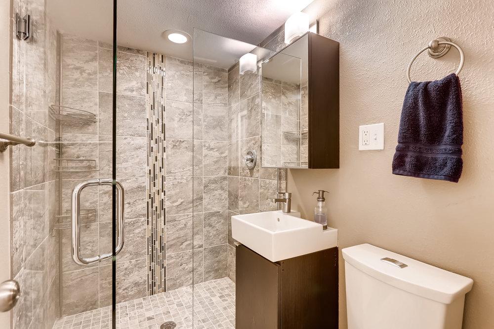 7330 E 12th St Denver CO 80220-print-025-26-Lower Level Bathroom-3600x2400-300dpi.jpg