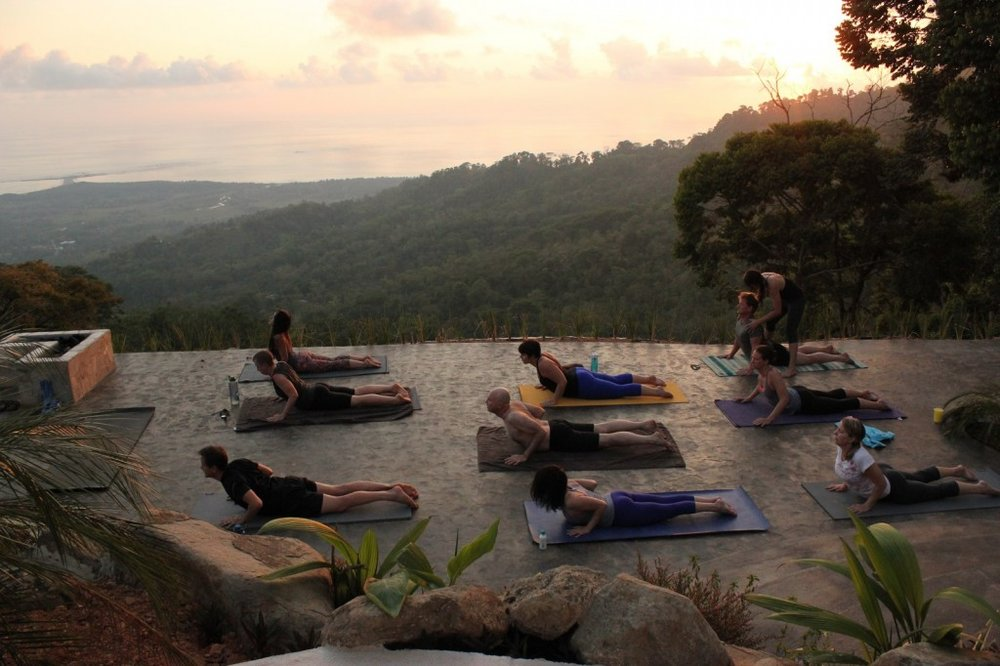 Sunset yoga at Vista Celestial by the fire pit,Costa Rica