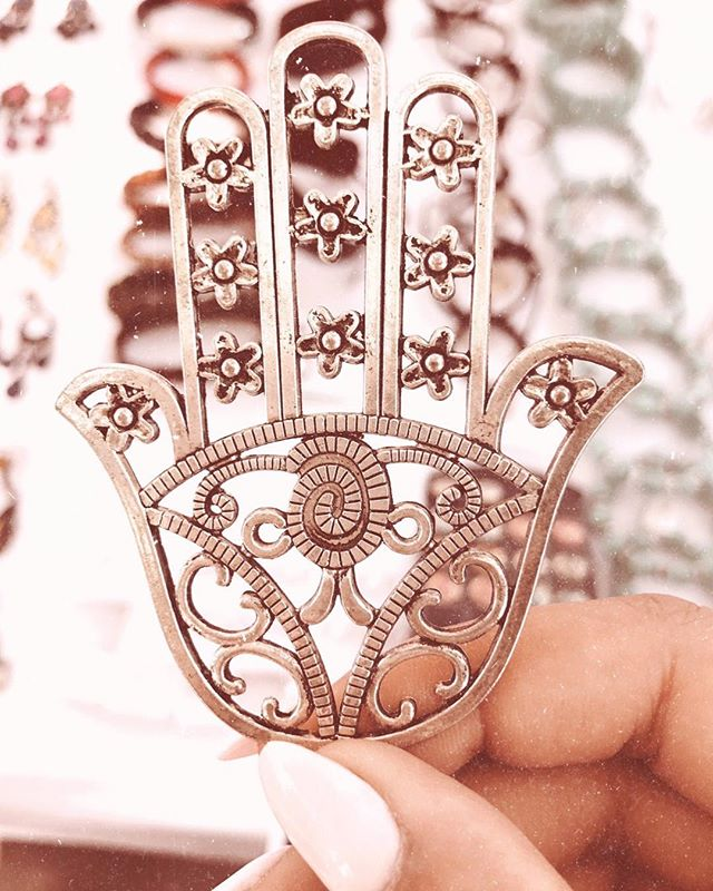 The Hamsa is known to bring happiness, luck, health, protection, and good fortune. Cheers!