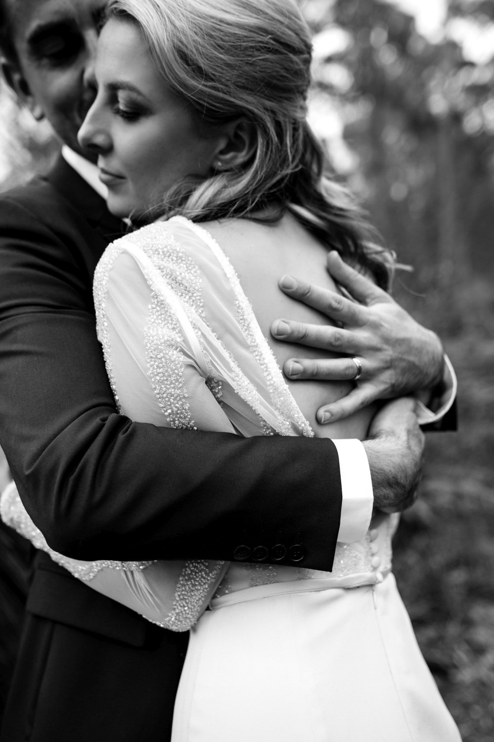 bride and groom hug tightly in a beautiful image by siida at bay of fires bush retreat.