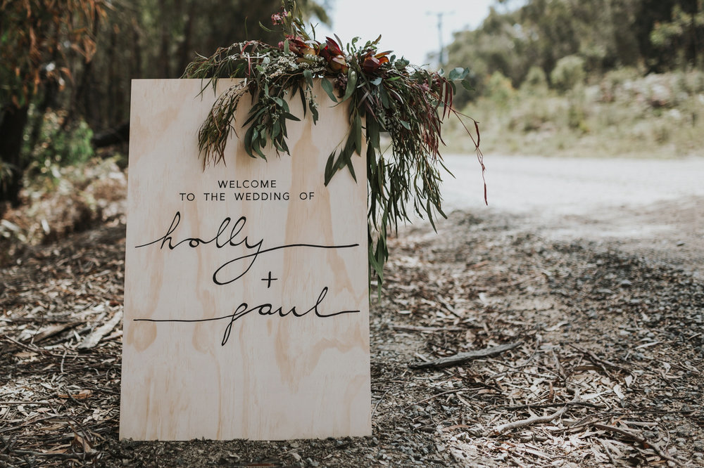 personalised wooden signage for wedding at bay of fires bush retreat.