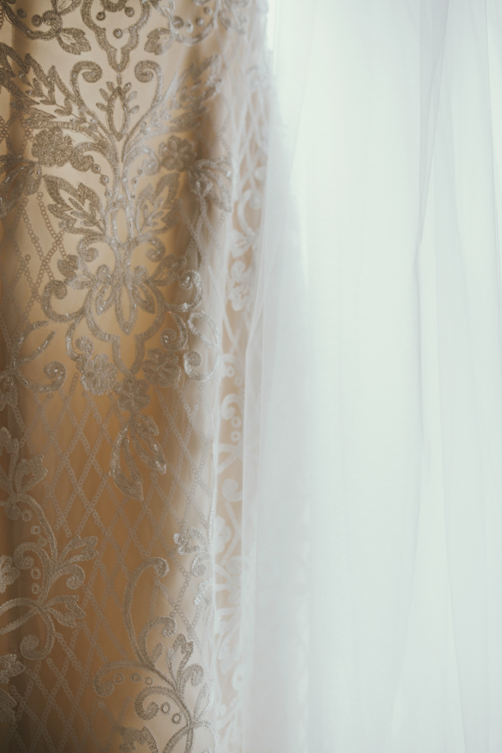 Beautiful close up image of the lace of bridal gown by siida photography.