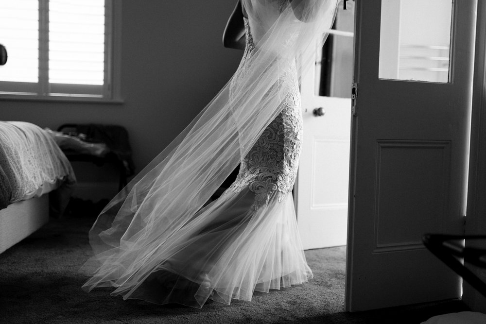 Beautiful image of lace dress with veil as bride prepares for her wedding day in Hobart.