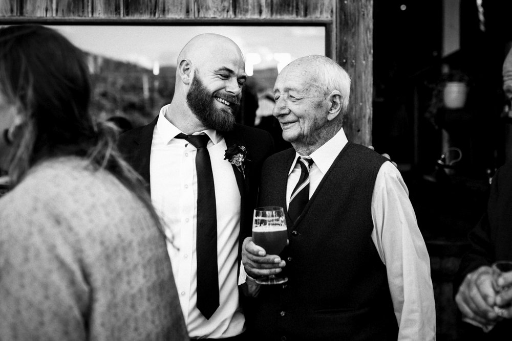 Documentary style photography of groom and his grandfather at willie smiths wedding in Hobart.