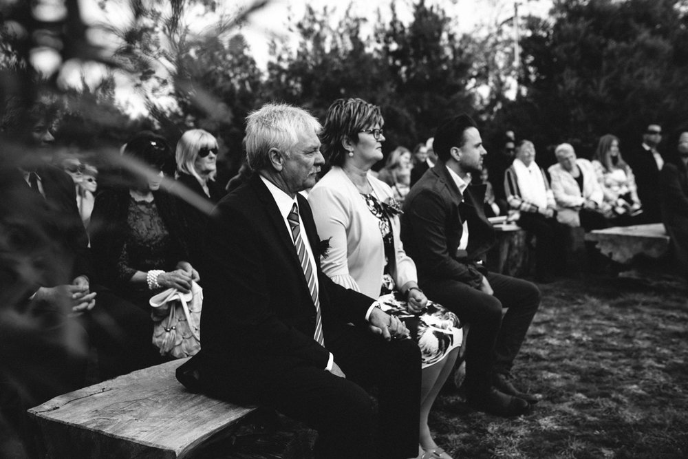 Guests watch as wedding proceeds in hobart tasmania.