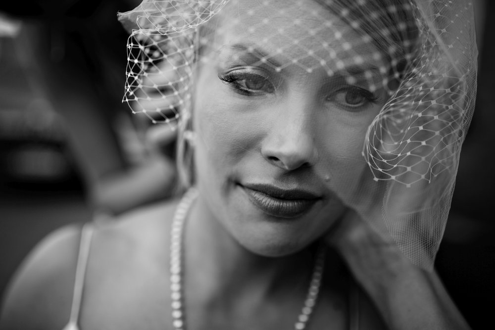Beautiful classic portrait of bride in short veil on her wedding day in Helsinki Finland.