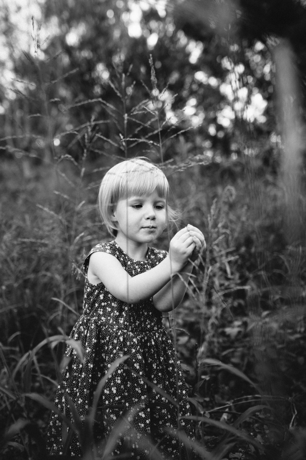 Girl explores in nature during a documentary style documentary photography session.