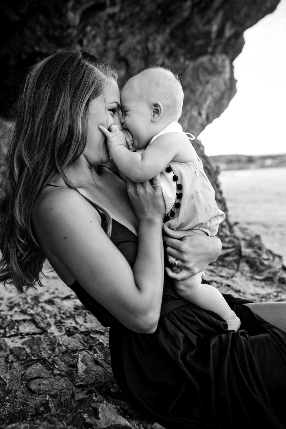 Mum and baby connect and smile during family photo session at Currumbin beach.