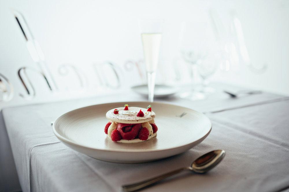 Crisp image of a sweet meringue dessert served in a fine dining restaurant.