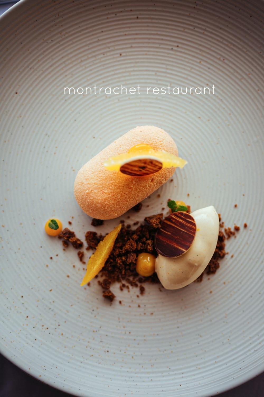 Image of dessert on a ceramic plate in Montrachet restaurant.
