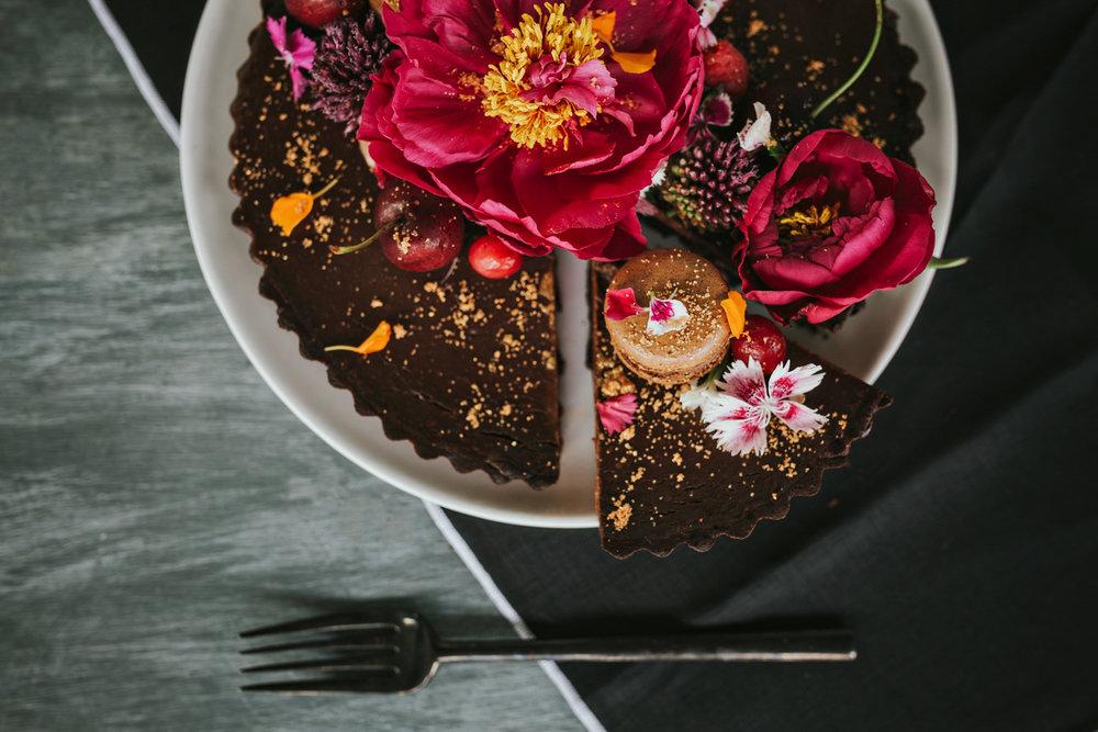Beautiful chocolate ganache tart on table.