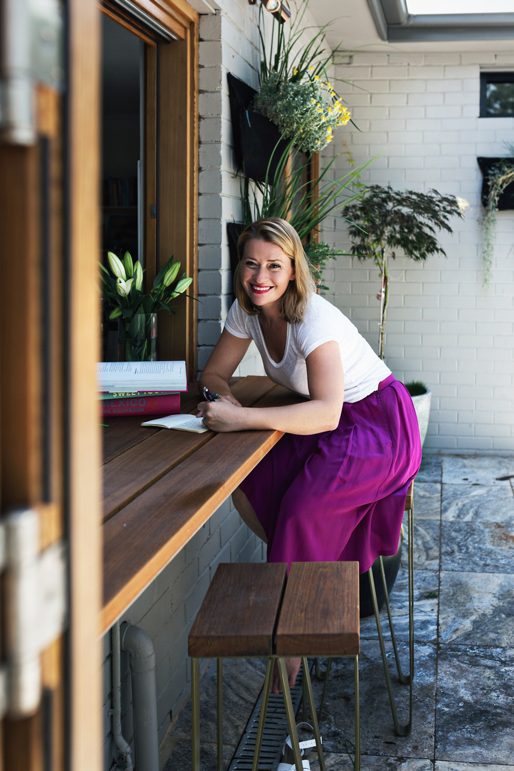 Food writer Katrina Meynink takes notes for her new cookbook during portrait session in Sydney Australia.