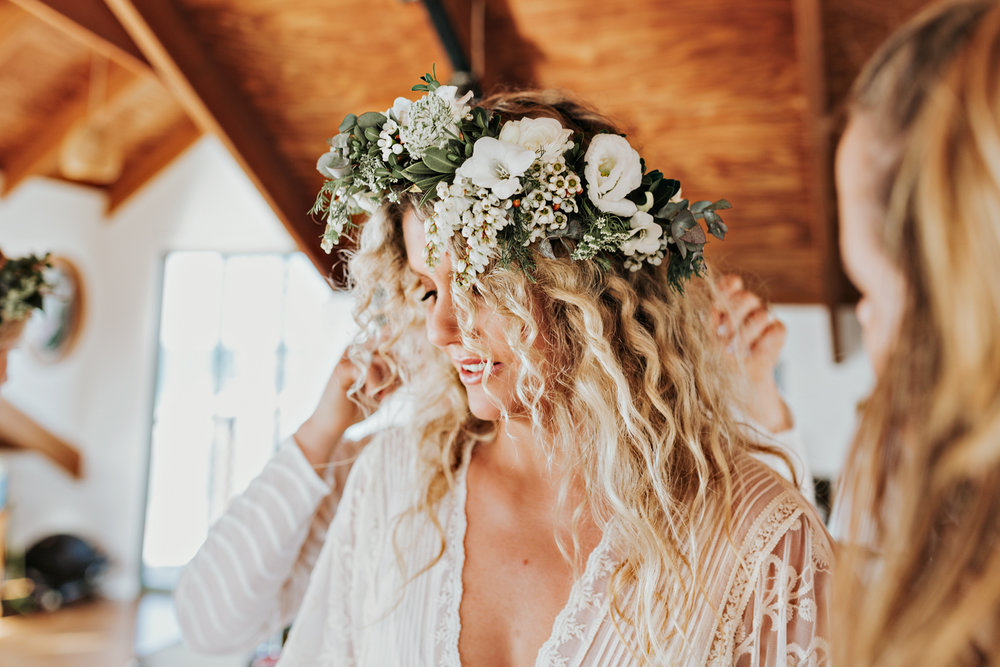 Bride prepares with flower crown at Byron Bay wedding with Siida