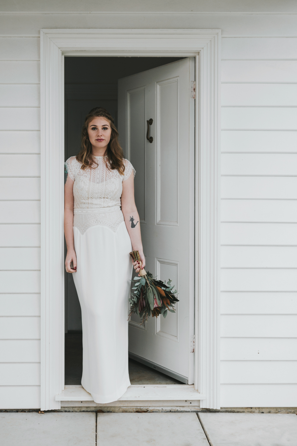 Portrait of bride at the door of Quamby House farm.
