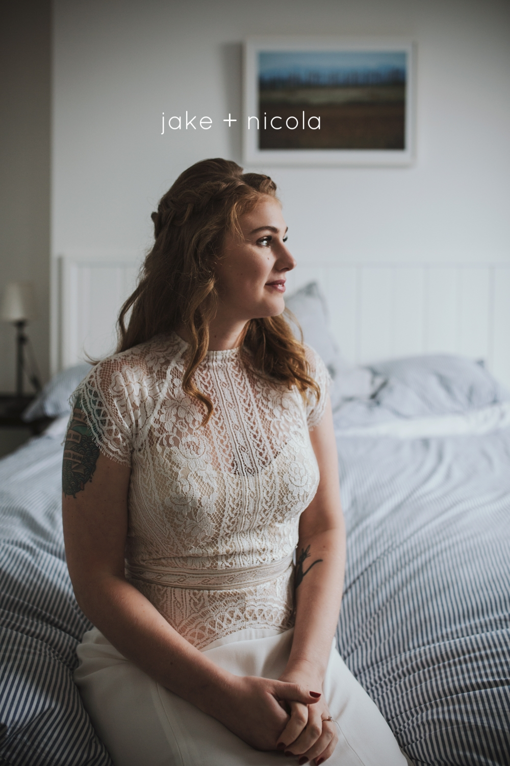 Bride sits on bed waiting for her wedding ceremony.