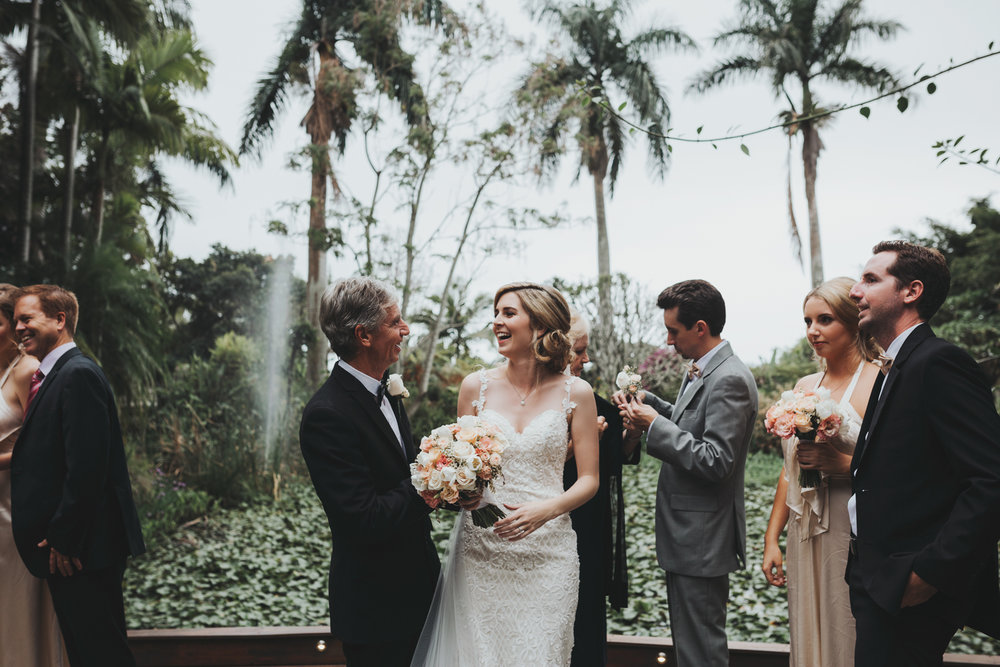 Bride laughs with father after wedding ceremony in Brisbane.