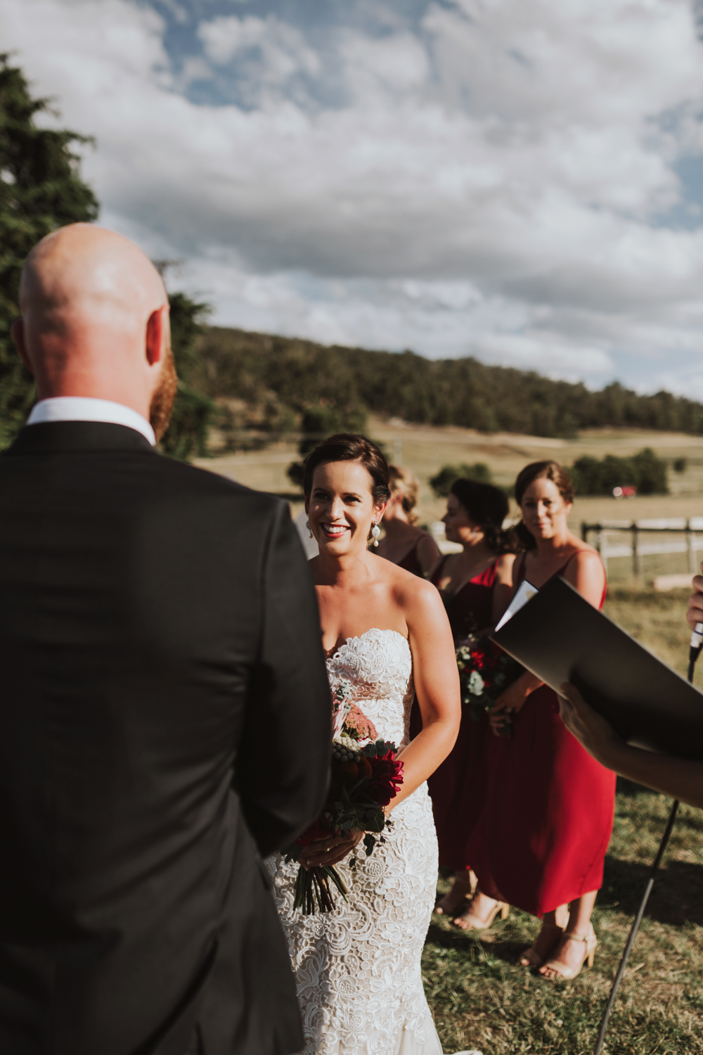 Bride smiles at her groom during wedding ceremony in Tasmania.