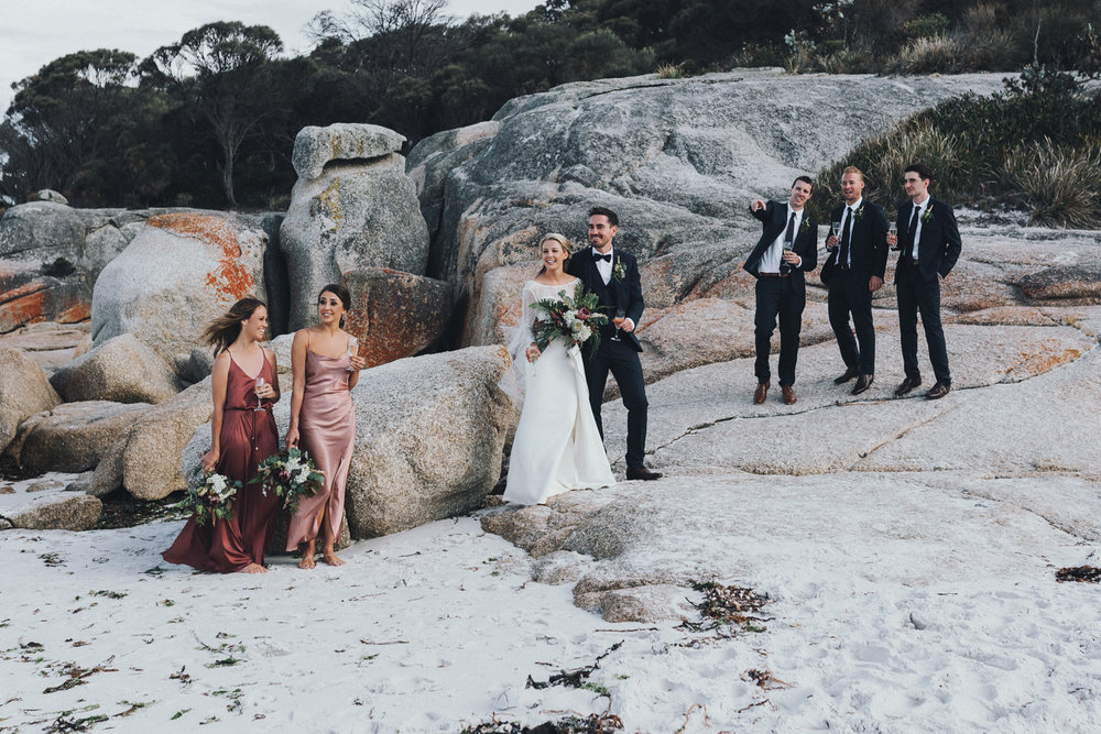 Bridal party relax in classic beach wedding with style in Tasman