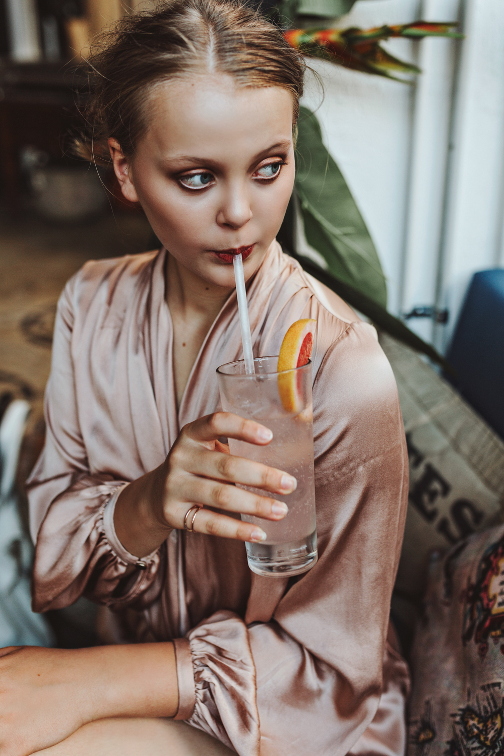 Model sips in an elegant shot for a fashion shoot in Brisbane.