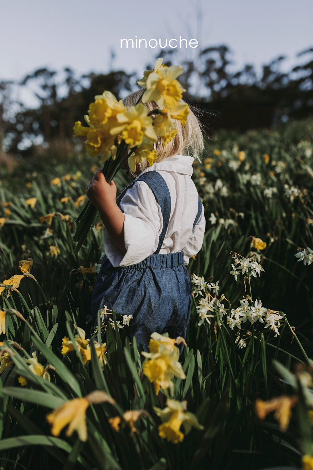 Girl holds bunch of flowers for a photo in Hobart by Siida Photo