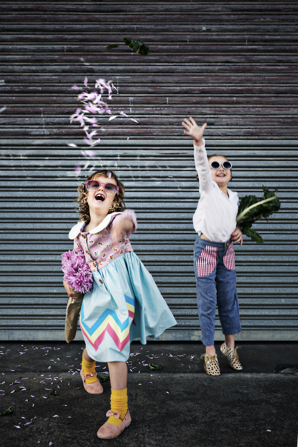 Girls throw flower petals in the air during fun kids commercial