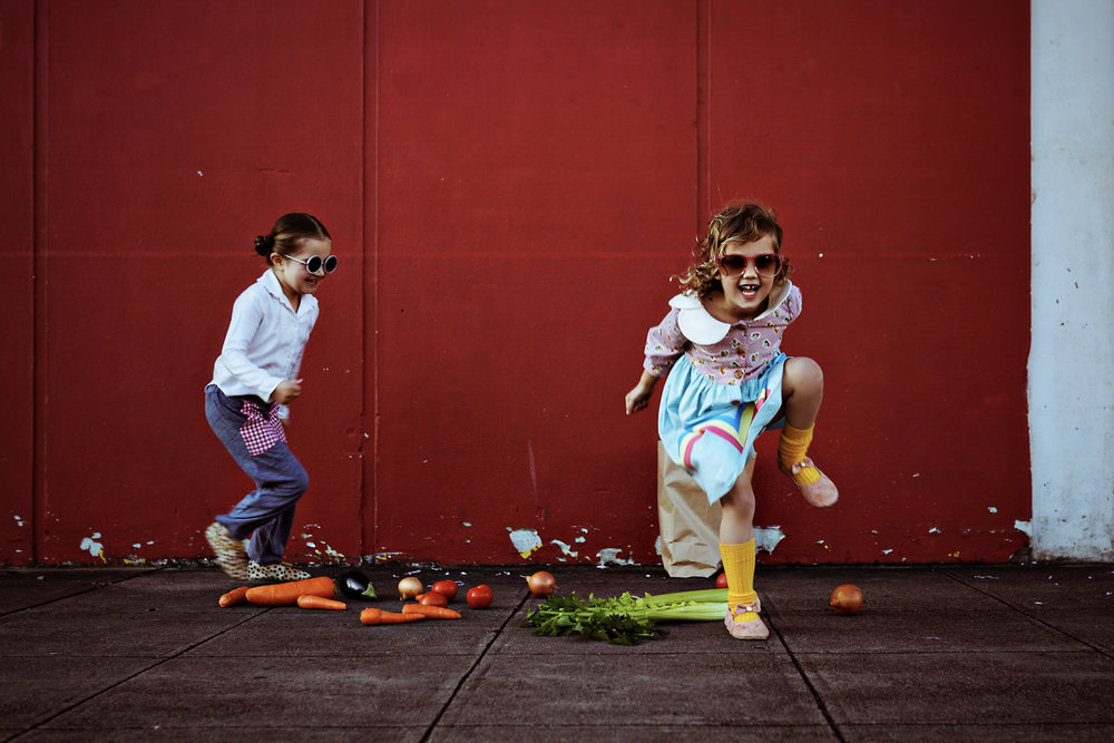 Girl skips over her upturned in vintage kids fashion shoot.