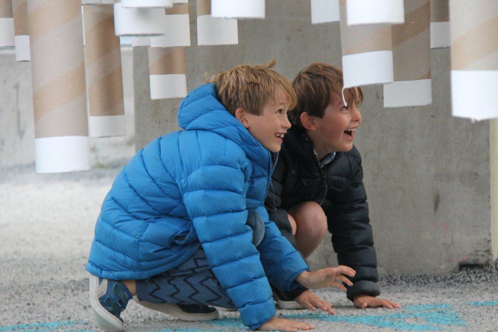 Two boys playing after the festival was opened to the public