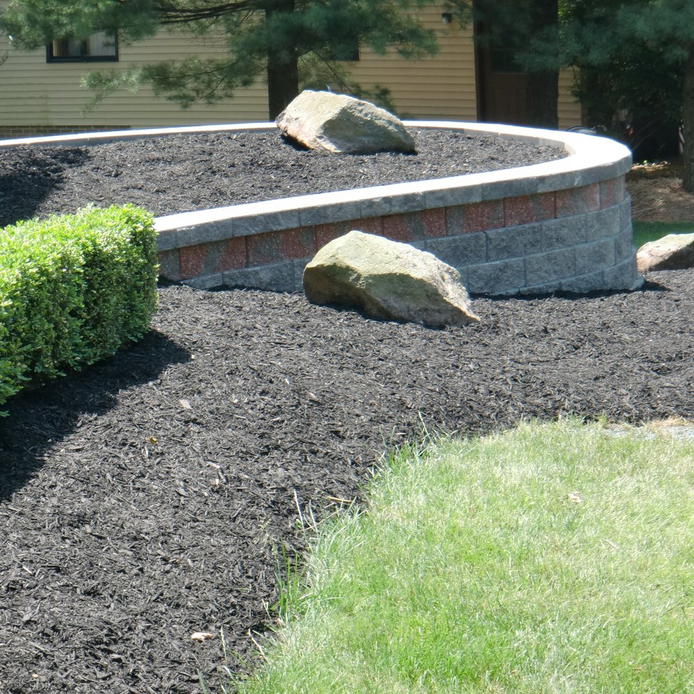 Retaining walls do a great job of adding dimension to landscapes. They also tie in the flowerbeds with the house to create a property that looks whole and complete from the street.