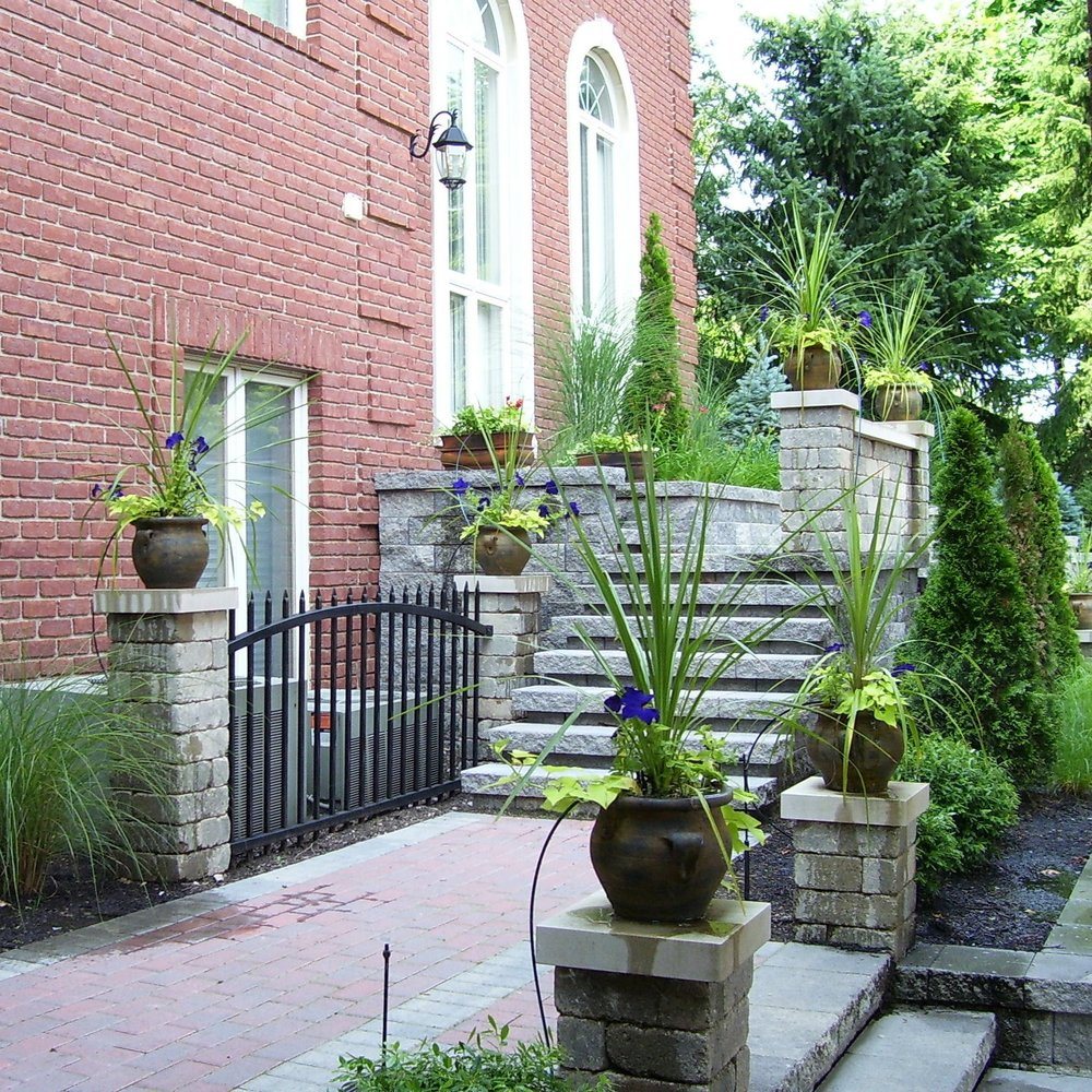 Stone steps framed with stone pillars create a three-dimensional space and add grandeur to any atmosphere.  Projects like this look great when accompanied with potted plants!
