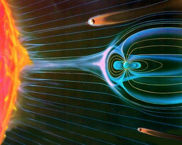 Figure 4: A cartoon that shows the burst of solar particles from the Sun, called a solar wind, towards the planet Earth. The Earth's magnetic field deflects the solar wind and protects the Earth from that blast of solar particles. The Earth's magnetic field acts like a shield to keep the solar particles from stripping away our atmosphere!.  Image from European Space Agency:  http://www.space.com/23131-earth-magnetic-field-shift-explained.html