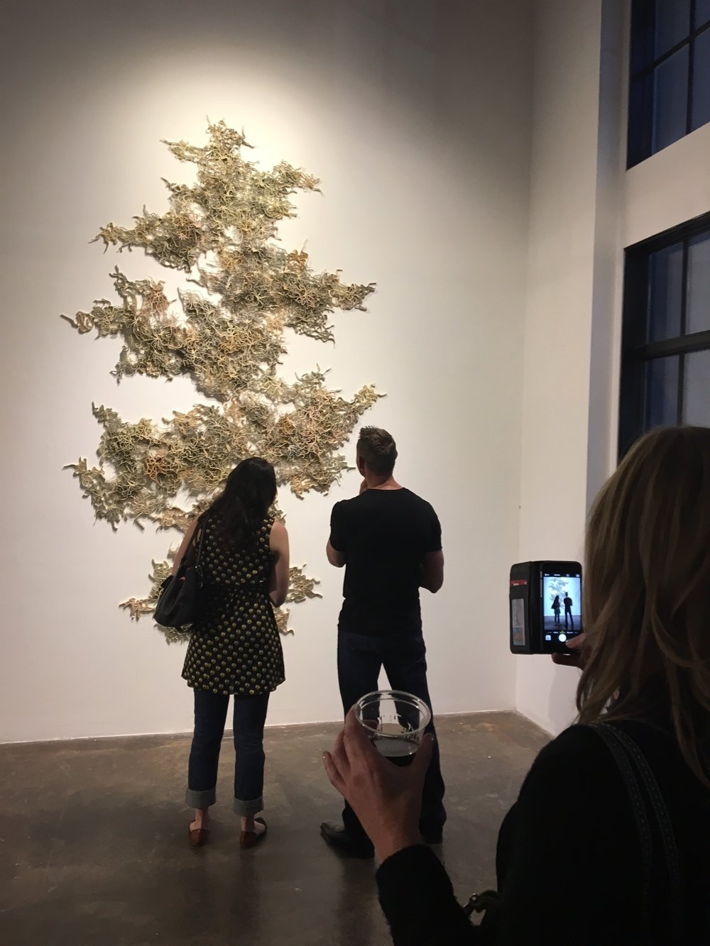 Opening night of Inherent Intent at Walker Fine Art in Denver, September 2016. Artwork: Cerebral Mapping, by Jessica Drenk, made of books and wax.