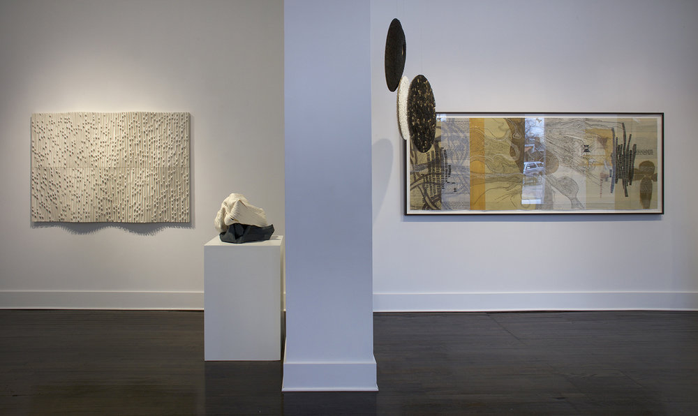 Left to right: Jessica Drenk's PVC pipe sculpture, a beautiful hand coiled porcelain ceramic sculpture by Cheryl Ann Thomas, Beth Dary's hanging pieces, and a large piece by printmaker Sarah Amos.