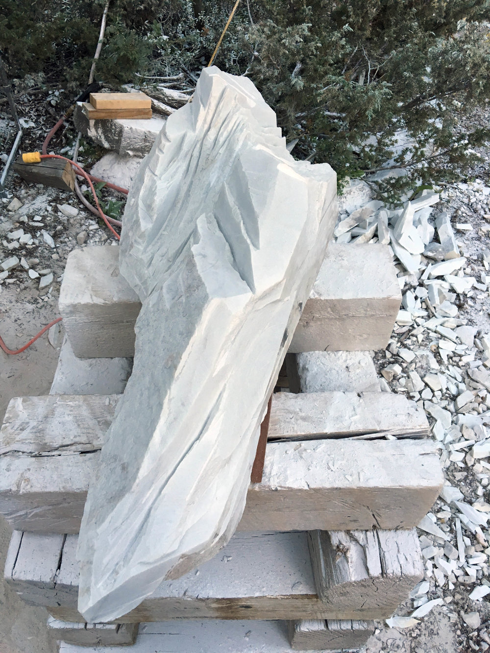 Initially stone is removed in large chunks by cutting through the marble with a diamond wheel on a grinder.