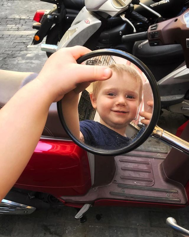 Mommy take the photo quickly because I'm going to break this stranger's mirror...