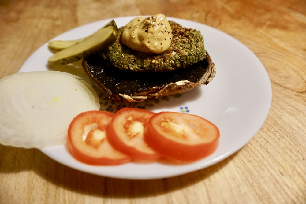 Lentil burger served on a portobello mushroom.