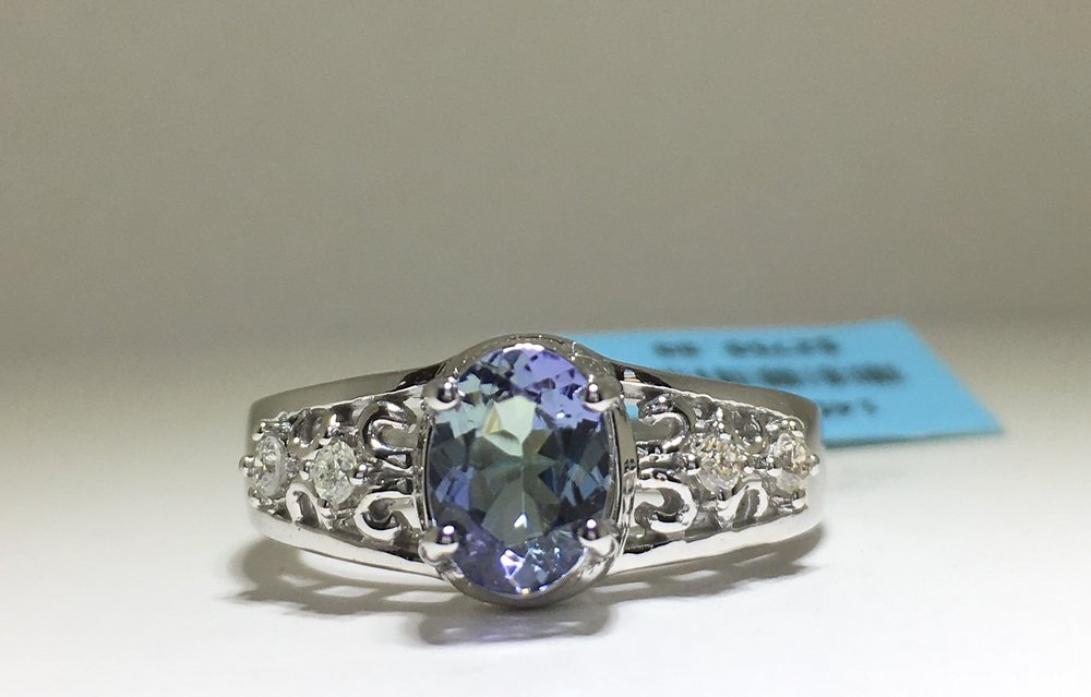 diamond this gem with ten peacock society international a gemstones in custommade cushion tanzanite permission article rivals fine deep cut ring blue than that of used ct rarer sapphire the