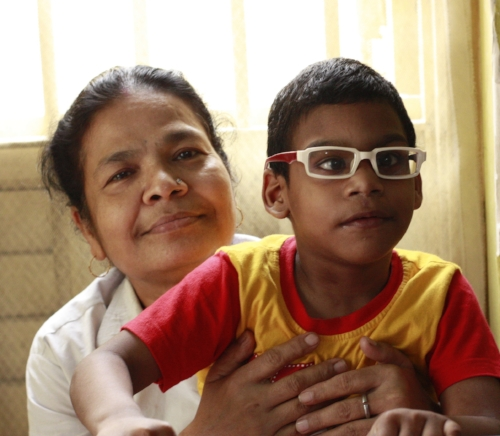 This boy, pictured with his caregiver, is in the Special Needs project at ISRC.