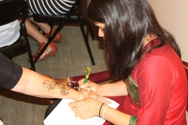 Our friend Trupti, offering her talents at the henna table.