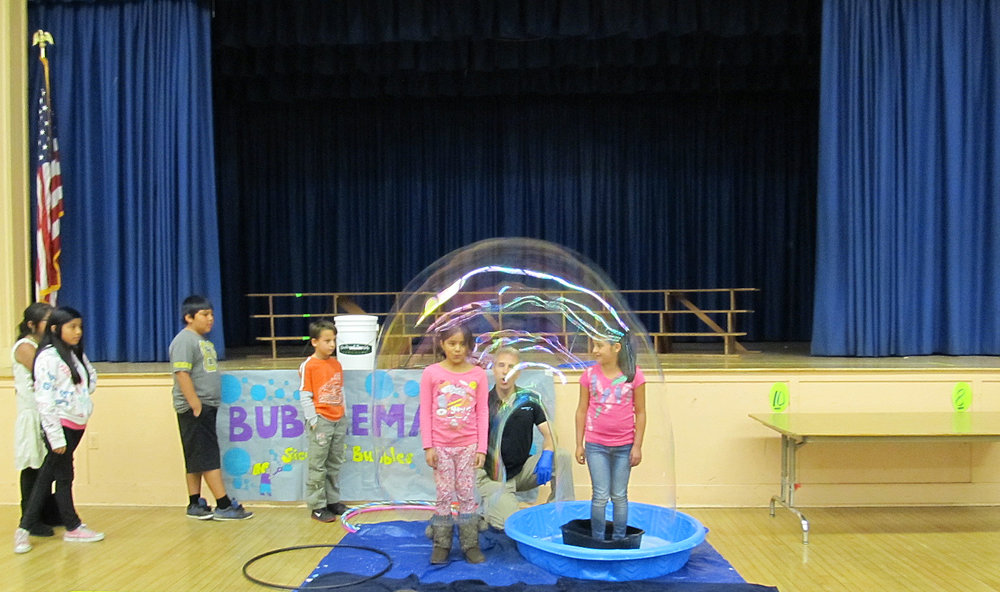 2 kids in bubble croped.jpg
