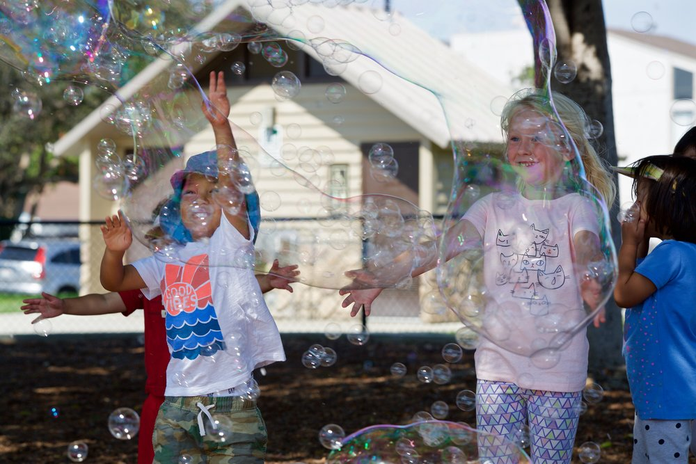 kids playing with bubbles 2.jpg