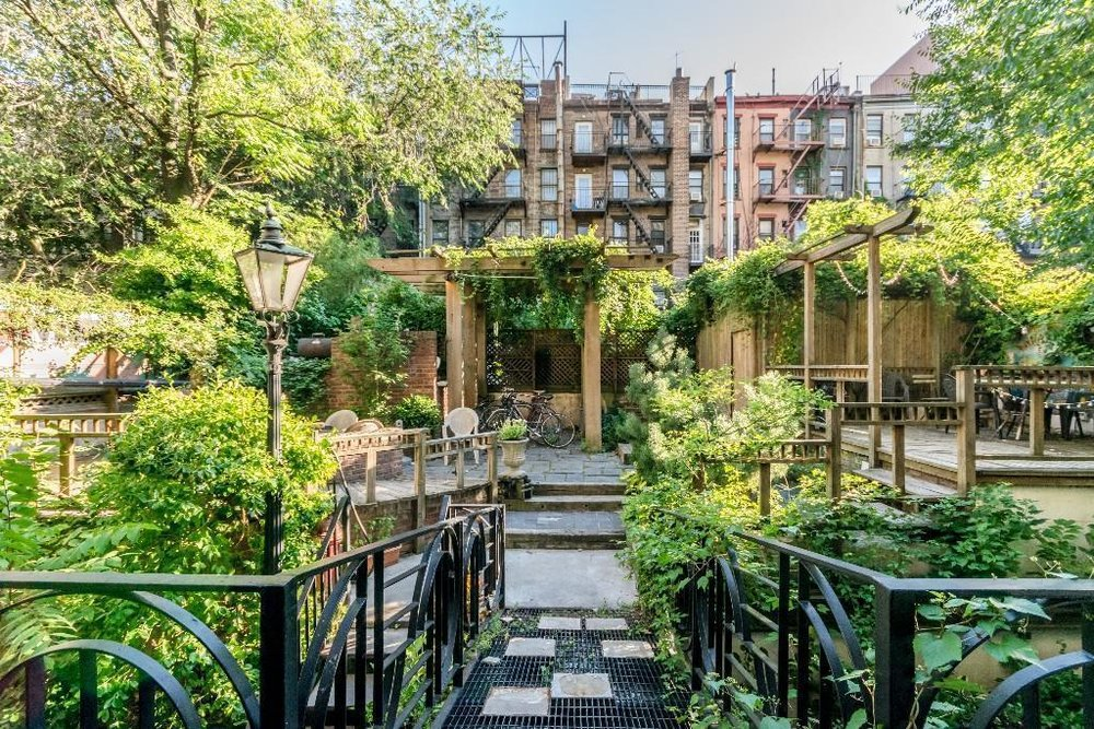 520 East 6th St. -        This building consists of ten recently renovated walk-up apartments. A huge backyard deck allows you to enjoy the outdoors in complete privacy. Located on a peaceful residential block in the East Village.