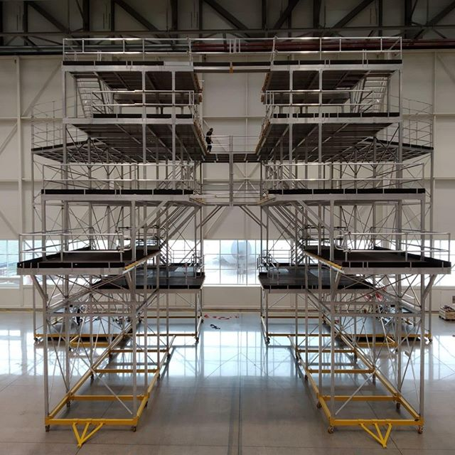 "Phase 2 successfully installed, 15m high Mobile ""Tail Dock"" System with (yellow) sliding fingers on multiple levels. #staging #access #designed #manufactured #installed #goodjob #welldone #planetplatforms"